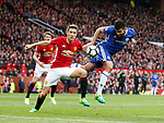 Diego Costa of Chelsea gets a header on target despite Ander Herrera of Manchester United during the English Premier League match at Old Trafford Stadium, Manchester. Picture date: April 16th 2017. Pic credit should read: Simon Bellis/Sportimage