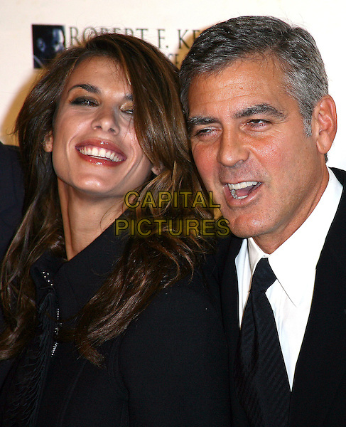 ELISABETTA CANNALIS & GEORGE CLOONEY .The Robert F. Kennedy Center for Justice & Human Rights Ripple of Hope awards dinner at Chelsea Piers, New York City, NY, USA, .17th November 2010..portrait headshot smiling black tie mouth open   white shirt couple .CAP/ADM/PZ.©Paul Zimmerman/AdMedia/Capital Pictures.
