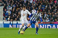 Real Madrid´s Nacho Fernandez and Deportivo de la Coruna's Albert Lopo during 2014-15 La Liga match between Real Madrid and Deportivo de la Coruna at Santiago Bernabeu stadium in Madrid, Spain. February 14, 2015. (ALTERPHOTOS/Luis Fernandez) /NORTEphoto.com