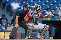Louisville Bats catcher Juan Graterol (3) sets a target as home plate umpire John Mang looks on during the game against the Durham Bulls at Durham Bulls Athletic Park on May 28, 2019 in Durham, North Carolina. The Bulls defeated the Bats 18-3. (Brian Westerholt/Four Seam Images)