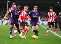 Lincoln City's Danny Rowe shields the ball from Grimsby Town's Mitch Rose, left, and Luke Hendrie<br /> <br /> Photographer Andrew Vaughan/CameraSport<br /> <br /> The EFL Sky Bet League Two - Lincoln City v Grimsby Town - Saturday 19 January 2019 - Sincil Bank - Lincoln<br /> <br /> World Copyright © 2019 CameraSport. All rights reserved. 43 Linden Ave. Countesthorpe. Leicester. England. LE8 5PG - Tel: +44 (0) 116 277 4147 - admin@camerasport.com - www.camerasport.com