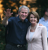 Washington, D.C. - June 19, 2007 -- United States President George W. Bush, left, poses for a photo with Speaker of The United States House of Representatives Nancy Pelosi (Democrat of California), right, at the Congressional Picnic on the South Lawn of The White House in Washington DC, Tuesday, June 19, 2007. <br /> Credit: Chris Kleponis - Pool via CNP