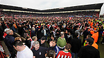 Stoke fans invade the pitch following their promotion to the Premier League during the Championship League match at The Britannia Stadium, Stoke. Picture date 4th May 2008. Picture credit should read: Simon Bellis/Sportimage