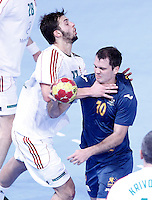 Australia's Caleb Gahan (r) and Hungary's Gabor Ancsin during 23rd Men's Handball World Championship preliminary round match.January 14,2013. (ALTERPHOTOS/Acero) /NortePhoto