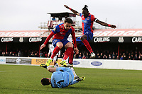 Nathan Smith of Dagenham and Jack Munns of Dagenham and Redbridge leap over David Gregory of Bromley during Dagenham & Redbridge vs Bromley, Vanarama National League Football at the Chigwell Construction Stadium on 9th March 2019