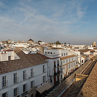 Calle Cardenal Herrero, and on the right, the wall of the Cathedral-Mosque of Cordoba and the roof around the Patio de los Naranjas or Orange Tree Courtyard, Cordoba, Andalusia, Southern Spain. The historic centre of Cordoba is listed as a UNESCO World Heritage Site. Picture by Manuel Cohen