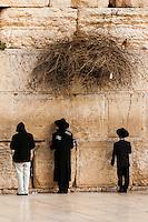 Jewish boys praying at the Western Wall (Wailing Wall), Jewish Quarter, Old City, Jerusalem, Israel.