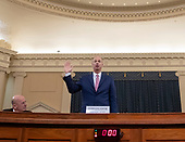 U.S. Ambassador to the European Union Gordon Sondland is sworn in during the House Permanent Select Committee on Intelligence public hearing on the impeachment inquiry into US President Donald J. Trump, on Capitol Hill in Washington, DC, USA, 20 November 2019. The impeachment inquiry is being led by three congressional committees and was launched following a whistleblower's complaint that alleges US President Donald J. Trump requested help from the President of Ukraine to investigate a political rival, Joe Biden and his son Hunter Biden.<br /> Credit: Erik S. Lesser / Pool via CNP