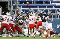 9 October 2010:  FIU's special teams unit (defensive end Tourek Williams (97), cornerback Jonathan Cyprien (25), cornerback Anthony Gaitor (7)) attempt to block an extra point in the fourth quarter as the FIU Golden Panthers defeated the Western Kentucky Hilltoppers, 28-21, at FIU Stadium in Miami, Florida.