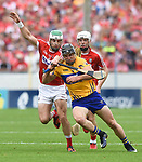 Shane Kingston of Cork in action against John Conlon of Clare during their Munster senior hurling final at Thurles. Photograph by John Kelly.