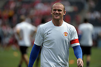 Manchester United's Wayne Rooney is all smiles before the game.  Manchester United defeated the Chicago Fire 3-1 at Soldier Field in Chicago, IL on July 23, 2011.