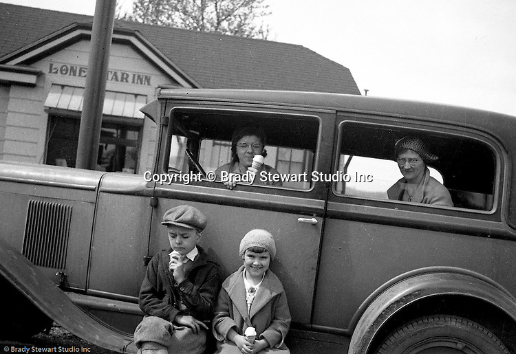 Markleysburg PA:  Stewart family taking a break off Route 40 on the way home from a vacation at Youghiogheny Lake - 1929. View the Stewart family eating ice cream cones in front of the Lone Star Inn which is still operating off Route 40.  Stewart's traveling in a 1928 Chevrolet AB National Coach