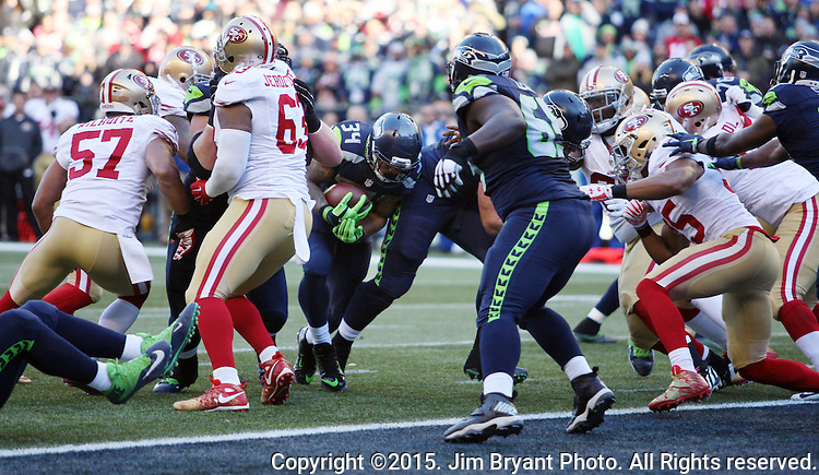Seattle Seahawks Running back Thomas Rawls (34) runs for a two-yard touchdown against the San Francisco 49ers at CenturyLink Field in Seattle, Washington on November 22, 2015.  The Seahawks beat the 49ers 29-13.   ©2015. Jim Bryant Photo. All RIghts Reserved.