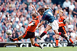 Marco Negri scores his fifth goal of the match against Dundee Utd at Ibrox. All five goals were scored by Negri