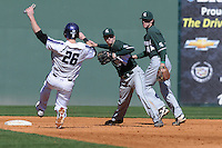 Shortstop Ryan Richardson (10) of the Michigan State Spartans turns a double play putting out Jack Havey (26) of the Northwestern Wildcats on Sunday, February 17, 2013, at Fluor Field at the West End in Greenville, South Carolina. (Tom Priddy/Four Seam Images)