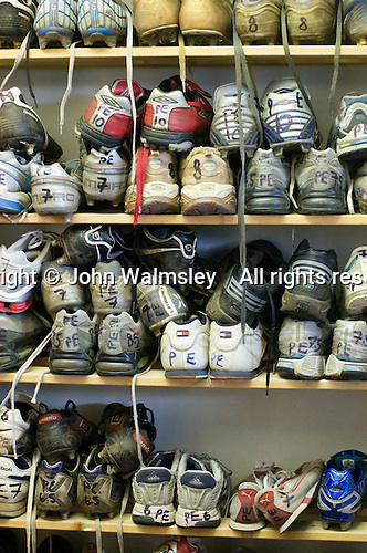 Collection of sports trainers/shoes left behind over the months now lent to students who've forgotten theirs.  State secondary school.