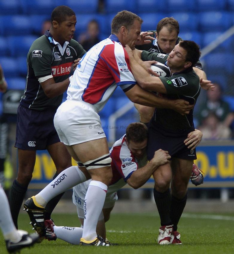 Photo: Jonathan Butler..London Irish v Bristol Rugby. Guinness Premiership. 16/09/2006..Justin Bishop of London Irish is tackled by Gareth Llewellyn of Bristol.