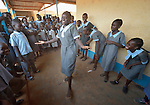 Nancy Ajok Majur, 12, leads a group of girl singers at the John Paul II School in Wau, South Sudan. The group sings songs focused on ending violence and empowering girls.