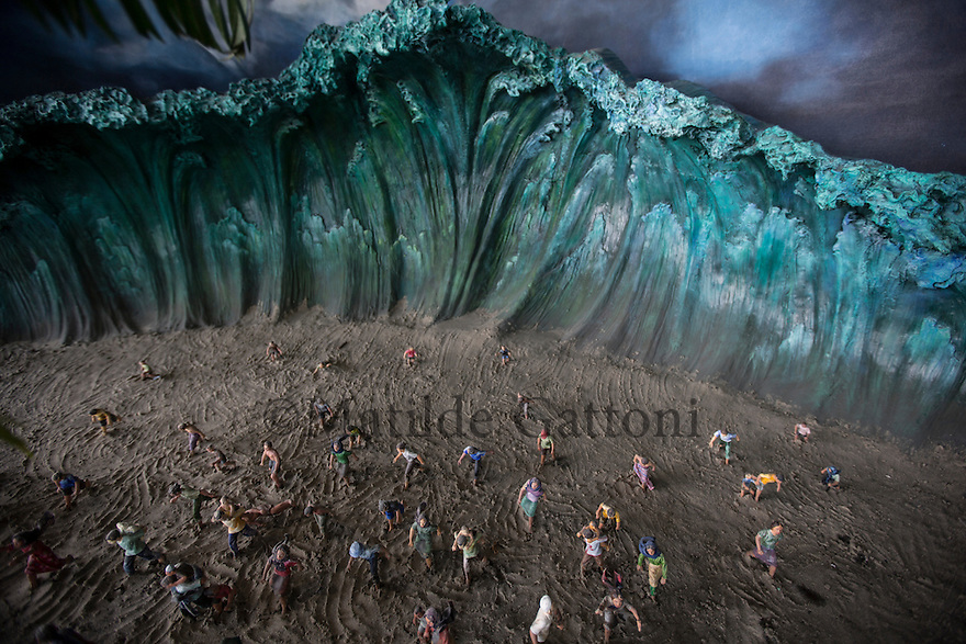 Indonesia - Sumatra - Banda Aceh - A miniature model at the Tsunami Museum depicting the scene of the tsunami and the inhabitants running away from the wave. The third and biggest wave is believed to have measured 15/20 meters. The 2004 tsunami was the strongest tsunami ever recorded on earth.