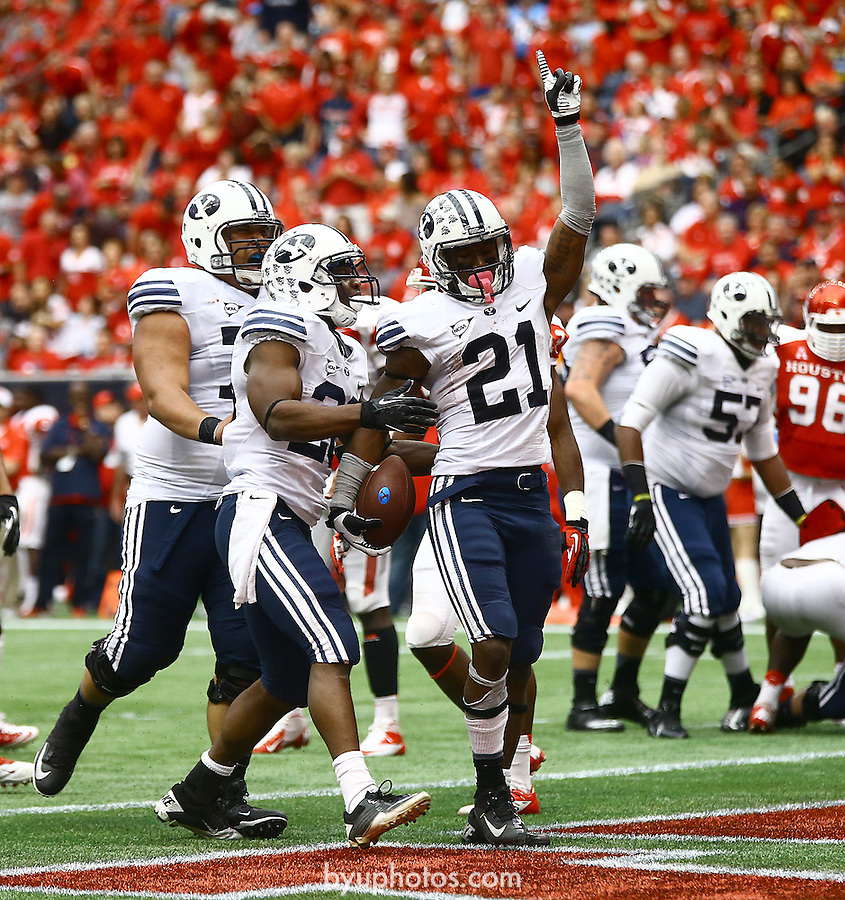 Williams TD 02MP0312<br /> <br /> 13FTB vs Houston<br /> <br /> BYU Defeats Houston 47-46.<br /> <br /> October 19, 2013<br /> <br /> Photo by Mark A. Philbrick/BYU<br /> <br /> &copy; BYU PHOTO 2013<br /> All Rights Reserved<br /> photo@byu.edu  (801)422-7322