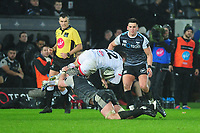 Bill Johnston of Ulster is tackled by Dan Lydiate of Ospreysduring the Guinness Pro14 Round 11 match between the Ospreys and Ulster Rugby at the Liberty Stadium in Swansea, Wales, UK. Saturday 15 February  2020
