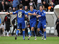 ATTENTION SPORTS PICTURE DESK<br /> Pictured: Cardiff players L-R Dekel Keinen, Mark Hudson and Paul Quinn celebrating their wn after the end of the game<br /> Re: npower Championship Swansea City FC v Cardiff City FC at the Liberty Stadium, south Wales. Sunday 06 February 2011
