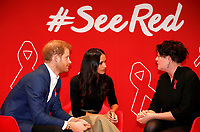 01 December 2017 - Prince Harry and Meghan Markle talk part in a discussion with HIV consultant doctor Laura Waters (R) during their visit to the Terrence Higgins Trust World AIDS Day charity fair at Nottingham Contemporary in Nottingham. Photo Credit: ALPR/AdMedia