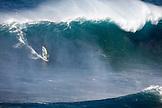 USA, Hawaii, Maui, a man windsurfs on huge waves at a break called Jaws or Peahi
