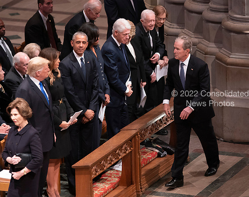 December 5, 2018 - Washington, DC, United States: Former President George W. Bush greets other former Presidents, their supposes and current President Donald J. Trump at the state funeral service of former President George W. Bush at the National Cathedral.  <br /> Credit: Chris Kleponis / Pool via CNP