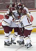 Melissa Bizzari (BC - 4), Emily Field (BC - 15), Kristyn Capizzano (BC - 7), Emily Pfalzer (BC - 14) - The Boston College Eagles defeated the Northeastern University Huskies 3-0 on Tuesday, February 11, 2014, to win the 2014 Beanpot championship at Kelley Rink in Conte Forum in Chestnut Hill, Massachusetts.