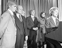 First Lady Betty Ford Reads President Gerald Ford's Concession Speech to members of the Press with (l-r) Steve, President Ford, Susan, Mike, and Gayle watching behind her. 3 November 1976