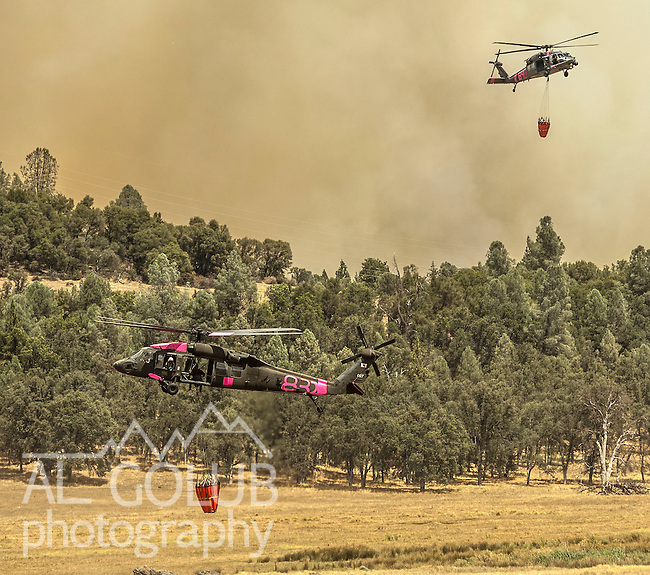 -Rim Fire- National Guard Black Hawks take turns getting water out of a small pond in Kasabaum Meadow 5 miles east of Groveland.