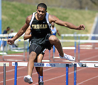 BENSALEM, PA - APRIL 12:  Truman's Gianni Adamo competes in the 300 meter hurdles during Bensalem Invitational boys track and field meet at Bensalem High School April 12, 2014 in Bensalem Pennsylvania. (Photo by William Thomas Cain/Cain Images)