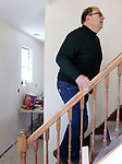 WATERBURY CT. 11 December 2018-121018SV09-Keith Weston, executive director of Habitat for Humanity checks out the remodeling progress at 23 Kramer Ave. in Waterbury Tuesday.<br /> Steven Valenti Republican-American