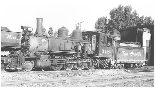 3/4 fireman's-side view of D&amp;RGW #318 at the Montrose engine house.<br /> D&amp;RGW  Montrose, CO  Taken by Ward, Bert H. - 7/7/1946