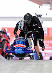18 December 2010: Ethan Albrecht-Carrie starts up his 2-man bobsled for the USA, finishing in 13th place at the Viessmann FIBT World Cup Bobsled Championships on Mount Van Hoevenberg in Lake Placid, New York, USA. Mandatory Credit: Ed Wolfstein Photo