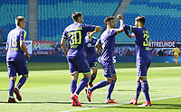 16th May 2020, Red Bull Arena, Leipzig, Germany; Bundesliga football, Leipzig versus FC Freiburg;  Goalscorer Manuel Gulde SCF celebrates with an elbow bump with Christian Guenter and Vincenzo Grifo as he scores for 0-1
