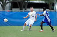 2 October 2011:  FIU midfielder Arnthor Kristinsson (19) passes the ball in the second half as the FIU Golden Panthers defeated the University of Kentucky Wildcats, 1-0 in overtime, at University Park Stadium in Miami, Florida.