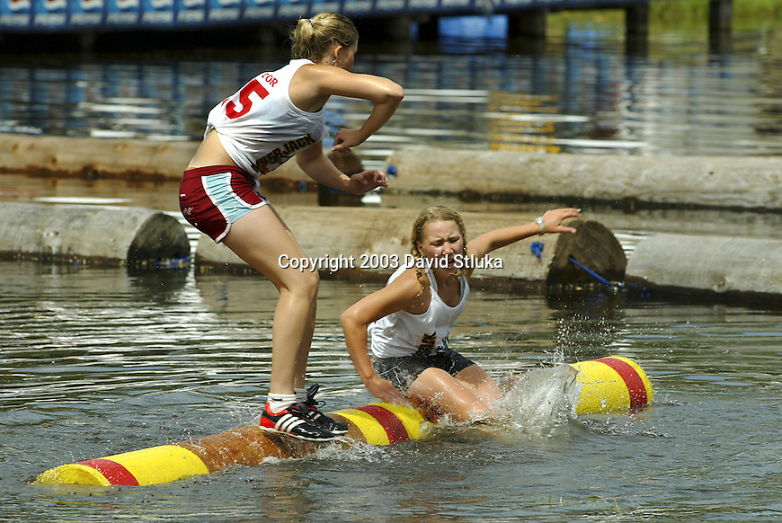 7/27/03 -Hayward, Wisconsin. Logrolling at the Lumberjack World Championships on Sunday. Mandy Erdmann (105) vs Abby Hoeschler (90). (Photo by David Stluka)