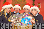 Hanora Brosnan, Doreen Moynihan Conor O'Mahony and Donnacha Buckley, Scoil Phobail Sliabh Luchra,  pictured as they put the finishing touches to one of the St Vincent de Paul hampers which will be distributed the Christmas...   Copyright Kerry's Eye 2008
