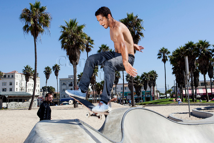August 2015. Venice, Beach skatepark, Los Angeles, California, USA. Model released image.   Skater performs tricks in the skate park in Venice Beach in Los Angeles, California, USA.