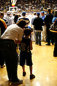 A young Duke fan and his mother during half-time at Cameron Indoor Stadium in Durham, N.C., Sat., March 6, 2010.