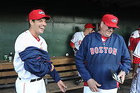 Left handed pitcher Rich Hill (53) of the Boston Red Sox laughs with pitching coach Dick Such (44) following a Major League rehab assignment with the Greenville Drive in a game against the Lakewood BlueClaws on April 7, 2012, at Fluor Field at the West End in Greenville, South Carolina. (Tom Priddy/Four Seam Images).
