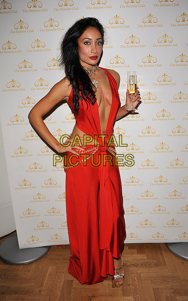 "SOFIA HYATT.At ""The Bloodlust Ball"", Trinity Church, Marylebone, London, England.25th October 2008.full length hand on hip costume red plunging neckline dress cleavage sophia hyat holding champagne glass beverage drink.CAP/CAN.©Can Nguyen/Capital Pictures."