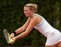 12-8-09, Den Bosch,Nationale Tennis Kampioenschappen, 1e ronde,  Marlot Meddens  in de regen