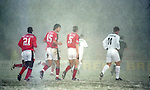 players leave the pitch as the snow falls, the match was later abandoned  - Premier League - Nottingham Forest v Tottenham  - City ground - Nottingham - England -  19th February1996 - Picture Sportimage