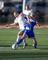 Boston Breakers midfielder Joanna Lohman (11) tackles Chicago Red Stars midfielder/forward Lori Chalupny (17).  In a National Women's Soccer League Elite (NWSL) match, the Boston Breakers defeated  Chicago Red Stars 4-1, at the Dilboy Stadium on May 4, 2013.