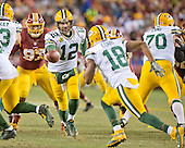 Green Bay Packers quarterback Aaron Rodgers (12) hands off to Green wide receiver Randall Cobb (18) in third quarter action against the Washington Redskins in an NFC Wild Card game at FedEx Field in Landover, Maryland on Sunday, January 10, 2016.  The Packers won the game 35 - 18.<br /> Credit: Ron Sachs / CNP