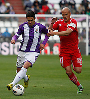 Real Valladolid´s Oscar (l) against Sevilla´s Hervas (r) during La Liga match. March 28, 2010. (ALTERPHOTOS/Víctor J Blanco)