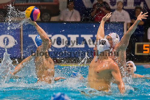 Italy's Christian Presciutti attacks against Hungary's Denes Varga and Norbert Hosnyanszky during the Volvo Water Polo Cup in Szekesfehervar, Hungary on January 07, 2012. ATTILA VOLGYI